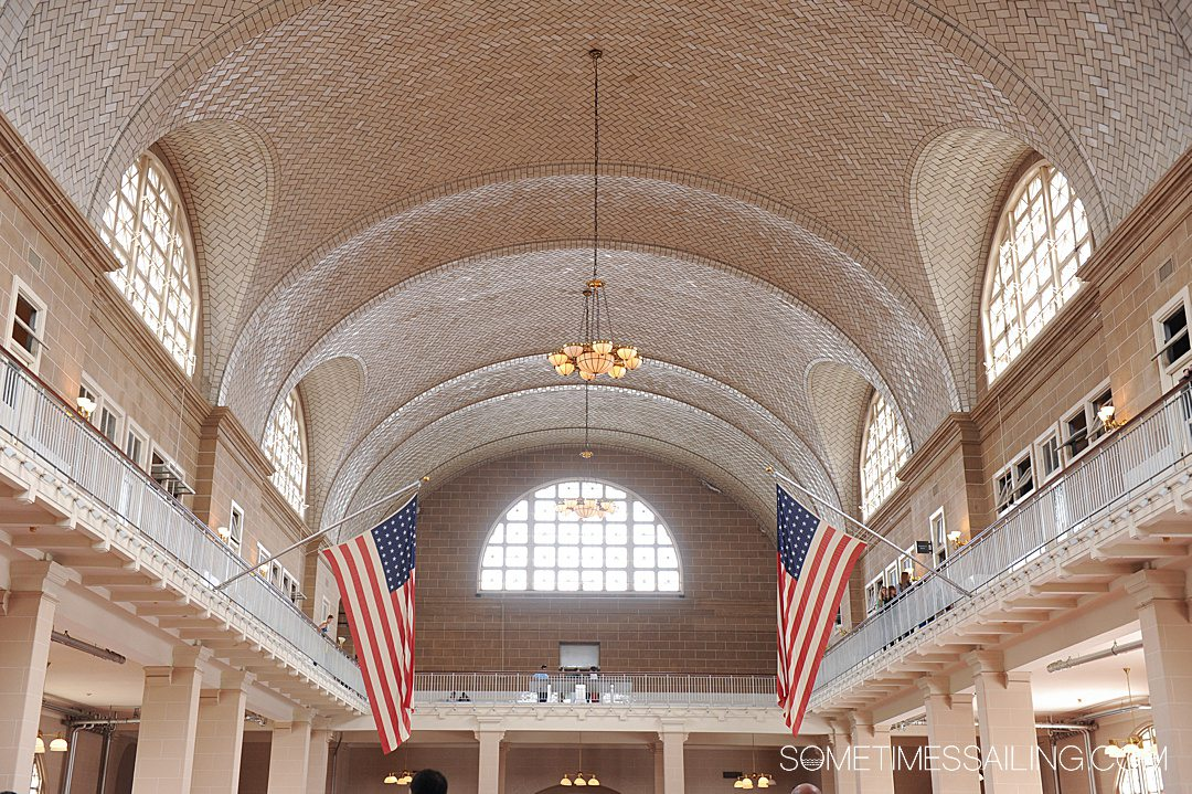 Interior tiled roof with two American flags on either side.