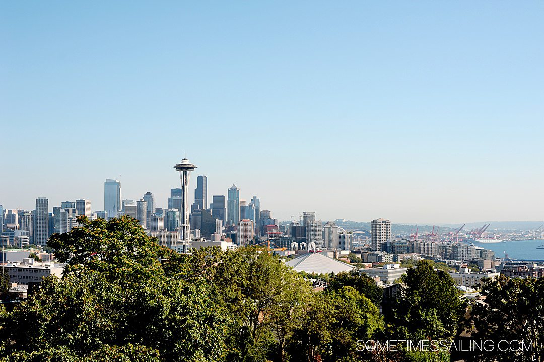 Image of the Seattle Skyline with ships in the harbor in the background.